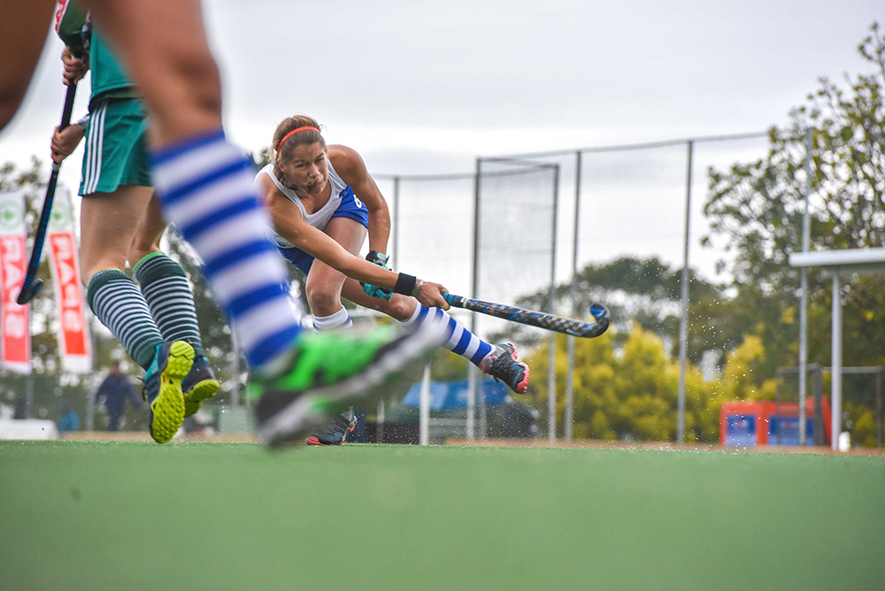Star player, Tegan Fourie from St Mary's DSG gets down low for a drag-flick during a short corner against Pietermaritzburg Girls' High School in the second semi-final at the SPAR KZN School Girls' Hockey Challenge that took place at St Mary's DSG.