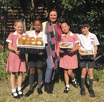 Getting ready for the Kainon Winter Market are Bailey Held, Zibusiso Luthuli, Mrs Jane Edmunds (Principal), Ella Huang and Caden Walker.