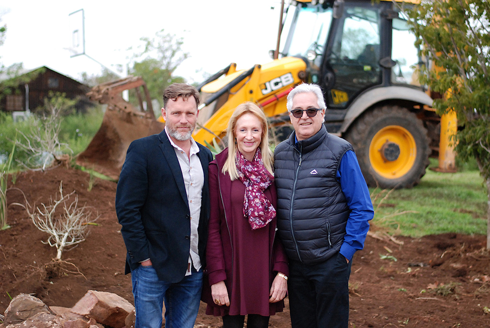 Waterfall Schools Directors Anthony Gibb, Jeanette van der Merwe (Principal of Waterfall College) and Danie van den Heever on the site of the new Waterfall College classroom block.