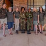 Craig Spencer, Carla Geyser, Jennifer Palmer, Tommi Wolfe, Bronwyn Laing and Emily Scott with two members of the Black Mamba Anti-Poaching Unit in SA, Felicia Mokokani, Colette Ngubeni (both in uniform). photo credit: Two Dustry Travellers)